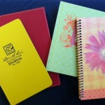 Sara's journals. Yellow is my everyday, red is my family holiday, green is letters to Jude, pink flower is letters to Ayla.